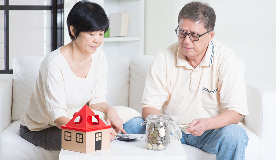Older couple looking into their finances