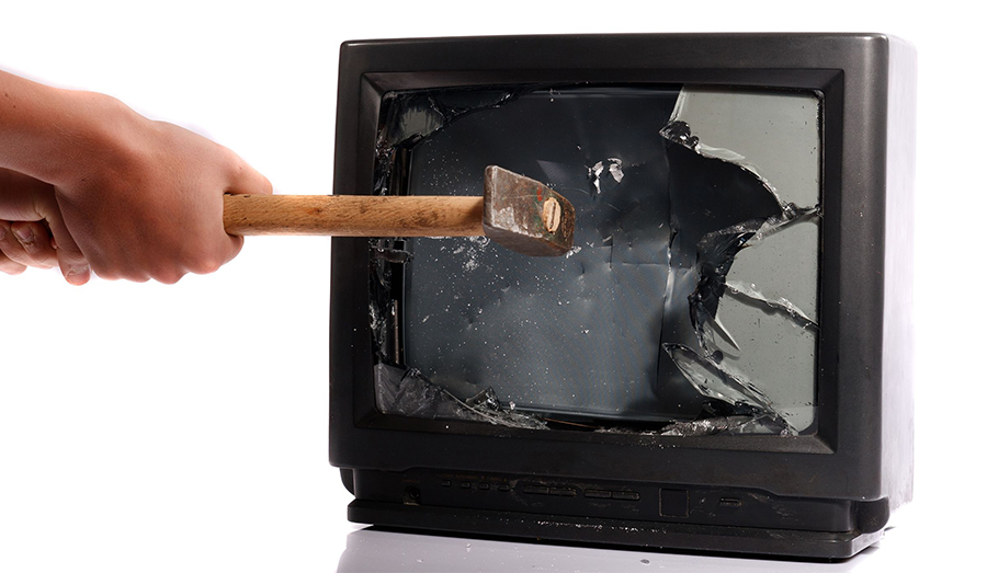 smashing a tv with a hammer