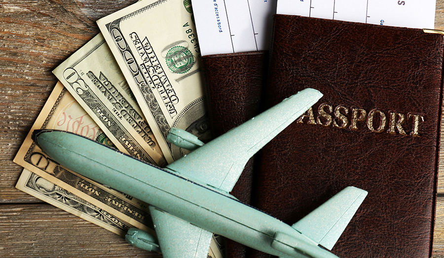 passport with cash and plane