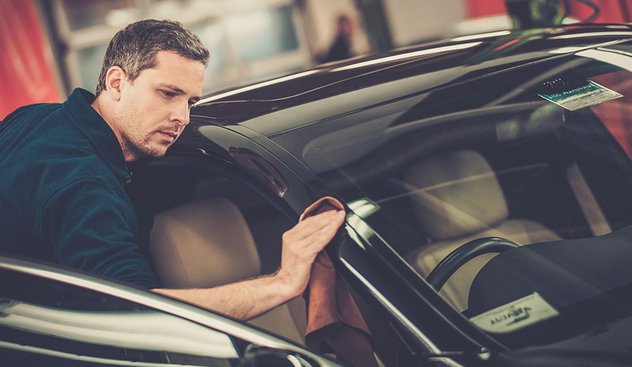 man checking out car