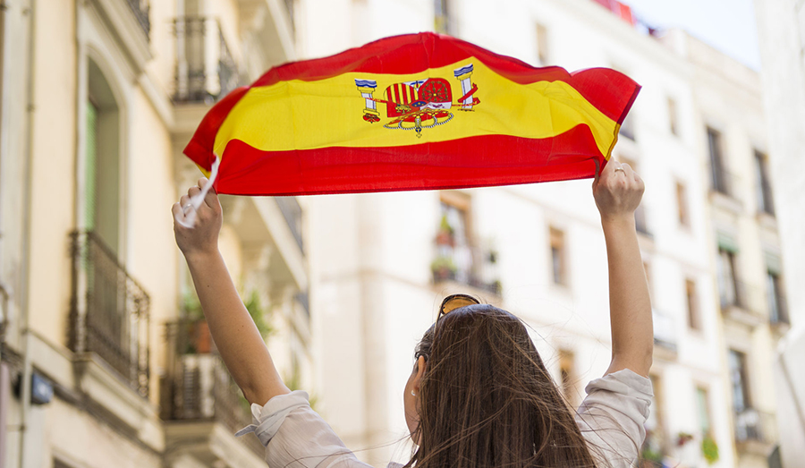 woman holding Spain flag