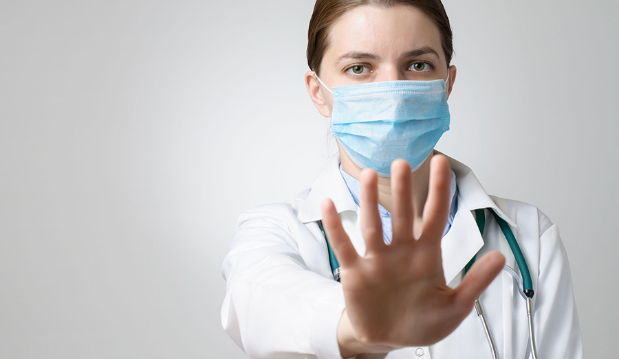 Nurse with face mask and gloves on
