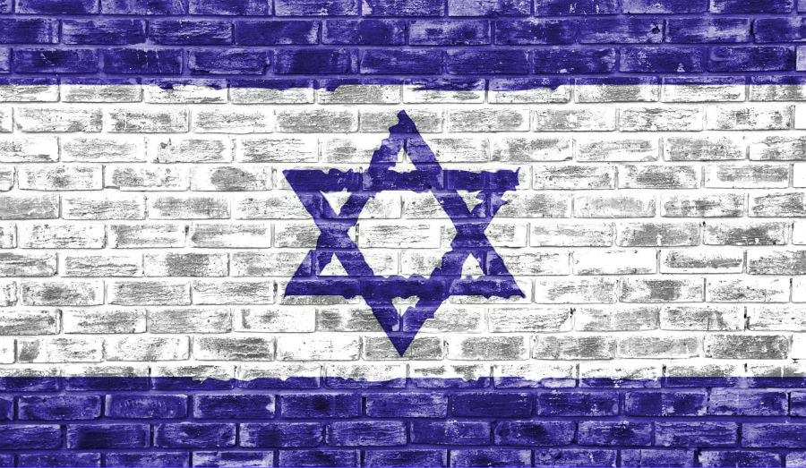 Israel flag on brick wall