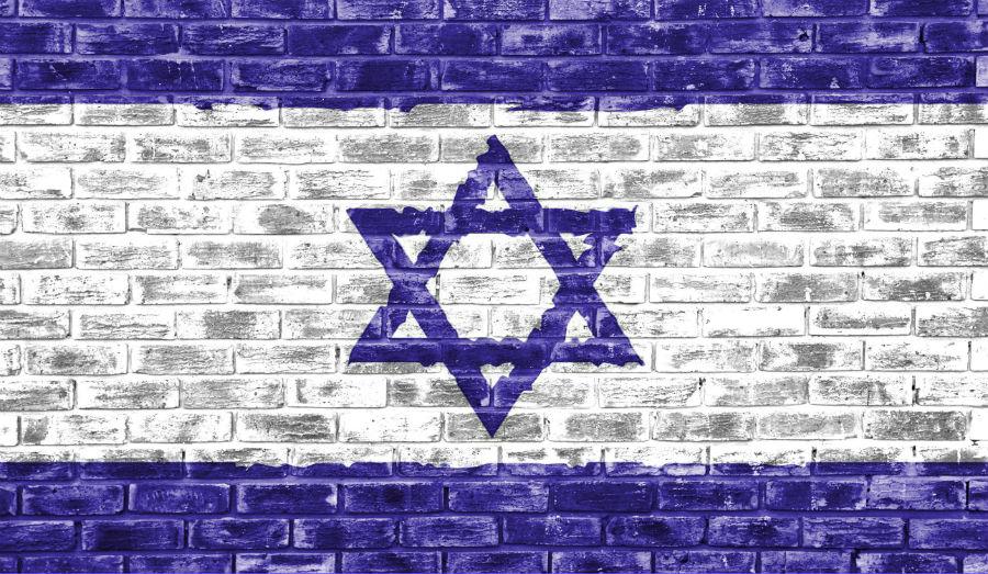 Israel flag on brick wall