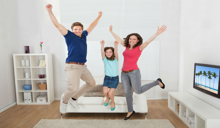 happy family jumping up and down