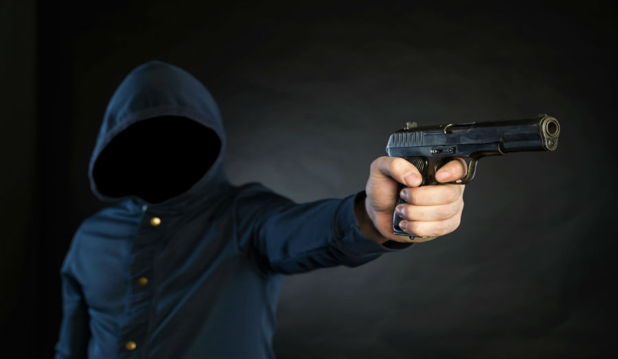 masked man with gun