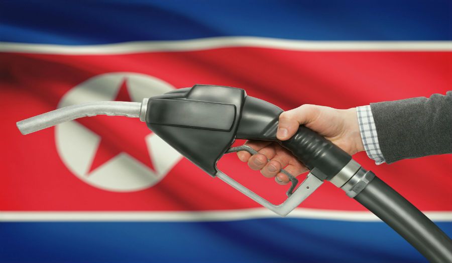 North Korea getting oil in front of flag