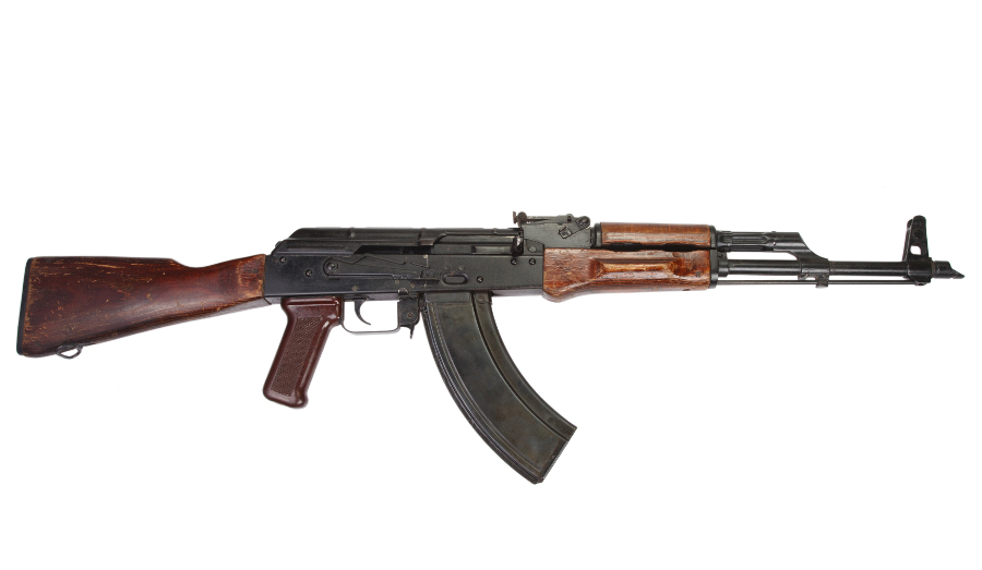 Fixed stock Soviet AKM with slabside magazine